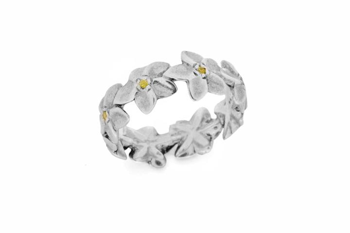 Silver Rhodium plated matt finish Yellow Sapphire frangipani eternity ring