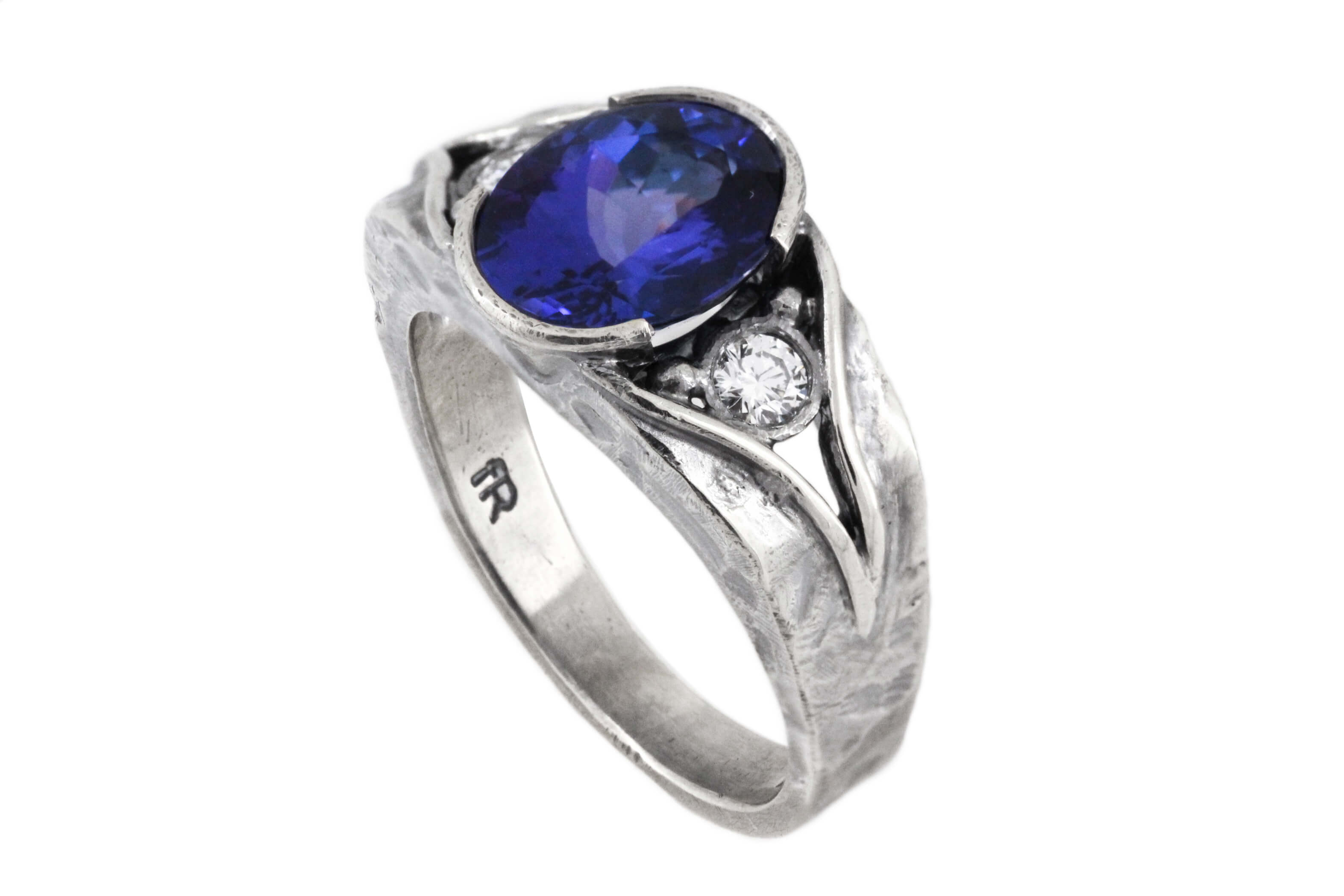Oval Tanzanite And Diamond Ring   2